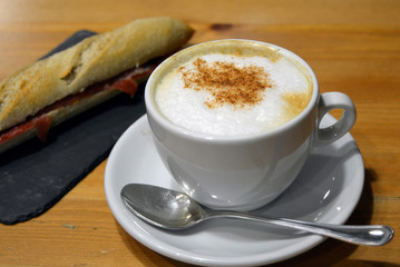 Prosciutto sandwich with cup of cappuccino