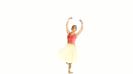 Young ballerina making dance trick, grands battements, on white