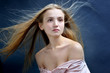 Beautiful woman with flying long hair.