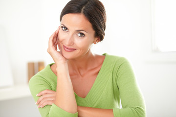 Charming adult woman smiling with satisfaction