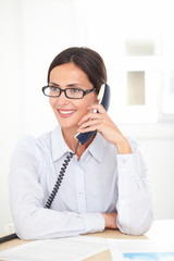 Latin receptionist conversing on the phone