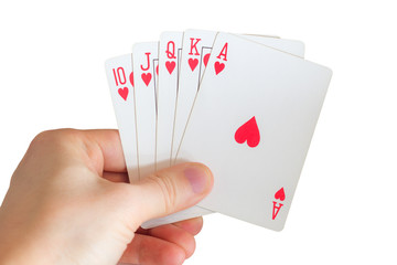Man's hand holding playing cards (straight/royal flush)