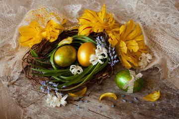 Easter eggs nest hyacinth tulip petals lace gold
