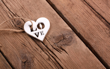 Heart with word ''love'' on wooden wall