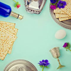 Jewish holiday Passover background with matzo, wine and flowers