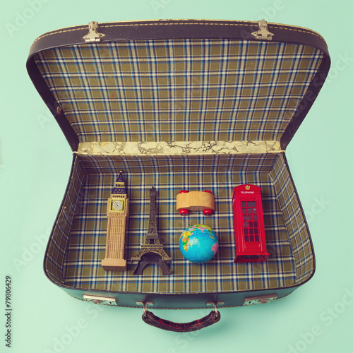 Summer vacation concept with suitcase and souvenirs - 79806429