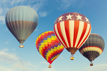 Hot air balloons flying over blue sky