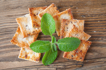 cookies and mint on a wooden background