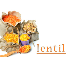 green, red and yellow lentils in the sacks and spoon wooden isol