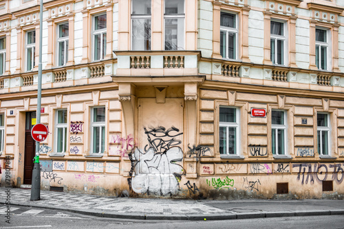 Historical building with walls painted in graffiti - 79807814