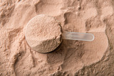 A scoop of chocolate whey isolate protein.