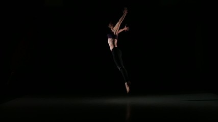 Modern girl dancing and jumping contemporary in the shadow on