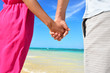 Holding hands romantic newlyweds couple on beach