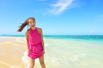 Asian Chinese tourist woman having fun on beach