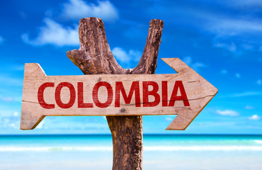 Colombia sign with a beach on background