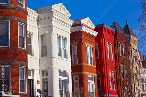 Colorful residential row houses under bright afternoon sun