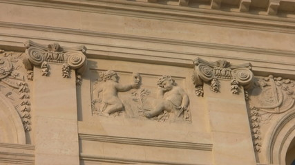 High relief wall in Versailles with two babies