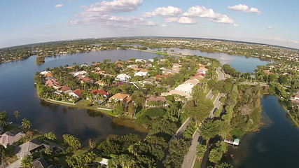 Suburban waterfront homes in Florida aerial view