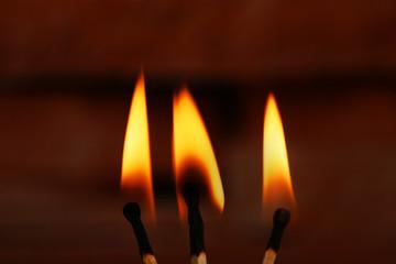 Burning match on color background