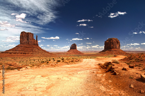 Poster Zandwoestijn Monument Valley under the blue sky