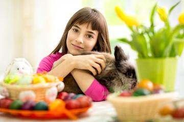 lovely girl hugging bunny