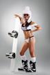 Sexy sportswoman with snowboard