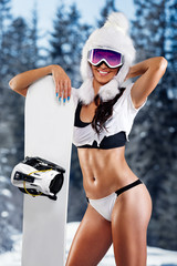 Attractive girl next snowboard