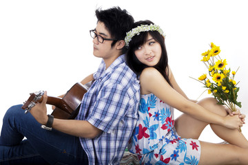 Chinese couple playing guitar isolated