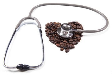 Closeup of coffee beans with stethoscope