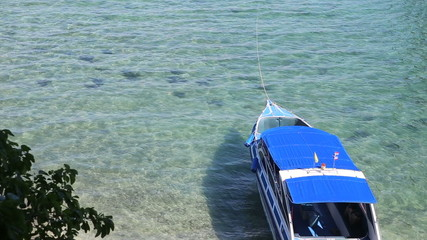 motor tourist speed boat tied up at sea coast