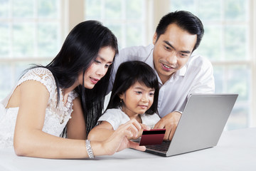Family doing purchasing online at home