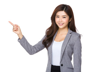 Business woman pointing one finger up