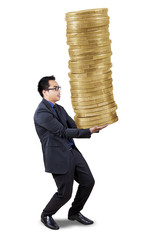 Male banker carrying golden coins