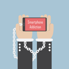 Businessman hands with smartphone and shackle, Smartphone addict