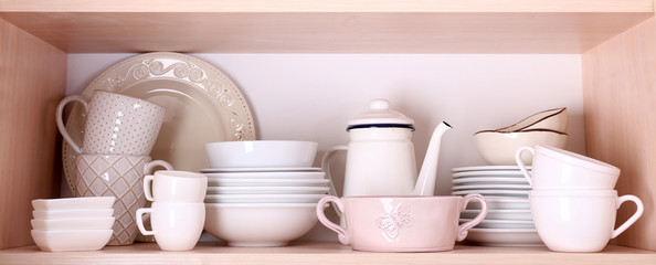 Tableware on wooden shelf
