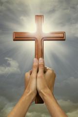 Prayer raise a cross wood to the sky