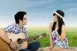 Romantic guy playing guitar for his girlfriend