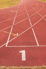 White lines and texture of running racetrack, red racetrack