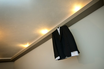 Groom costume hanging by the wall