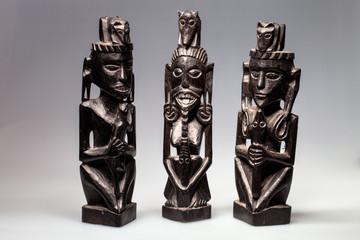three ethnic wood carved sculptures Borneo