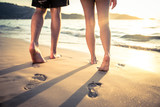 Fototapety Lovers walking on the beach