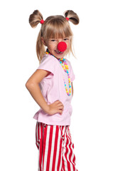 Little girl with clown nose