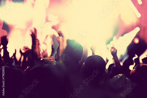 Concert, disco party. People with hands up in night club. - 79828031