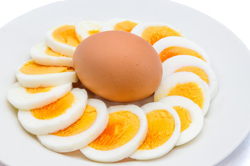 Sliced boiled egg arranged on a white plate