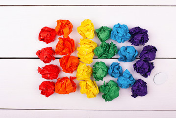 Colorful crumpled paper on a white background.