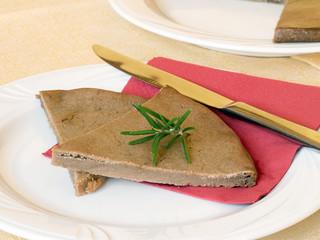 Tuscan Castagnaccio cake, made with chestnut flour.