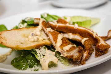 Breaded Chicken on Caesar Salad