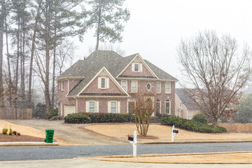 Nice Brick House wtih New Snow Falling