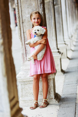 Happy Young Girl with her Dog in the City Venice, Italy.
