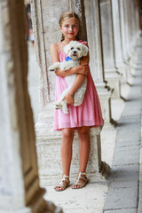 Happy Young Girl with her Dog in the City Venice, Italy. Youth L